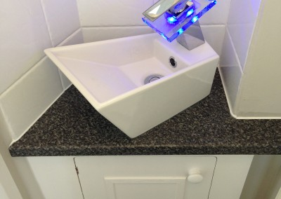 Cloakroom basin installation